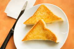 Golden triangle toast in the white dish Stock Image