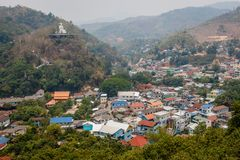 Golden Triangle. View of a big Buddha statue on the hill in Mae Sai, Thailand and border town Tachileik in Myanmar. Golden Triangle. View of a big Buddha statue royalty free stock photos