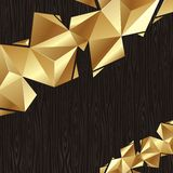 Golden triangular elements on a black wood board Royalty Free Stock Photo