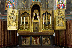 Golden triptych and altar. Golden triptych that was handcrafted centuries ago. Very detailed piece of artwork royalty free stock photography