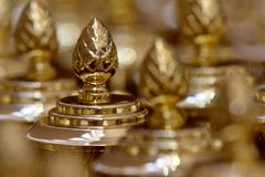 Golden trophies - award ceremony royalty free stock image