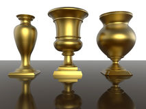 Golden trophies. 3D render illustration of three golden trophies. The trophies are positioned on a dark reflective background Royalty Free Stock Image