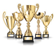 Golden trophies. Set of golden trophies on white background Royalty Free Stock Photography