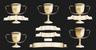 Golden Trophy. Golden trophies and banners with dark background Royalty Free Stock Photo