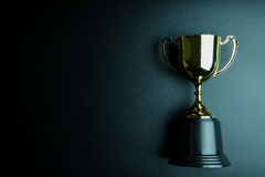 Golden trophy on black background with copy space.Conce. Pt winner royalty free stock photography