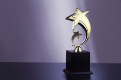 Golden trophy. On the black table top royalty free stock photography