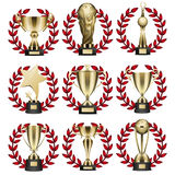 Golden Trophy Collection in Round Wreaths on White Royalty Free Stock Photos