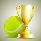 Golden trophy cup with a Tennis ball. Royalty Free Stock Photos