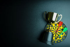 Golden trophy, Darts with crotch on black background wi. Th copy space.Concept winner royalty free stock photography