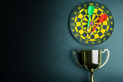 Golden trophy, Darts with crotch on black background wi. Th copy space.Concept winner stock images