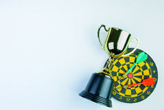Golden trophy, Darts with crotch  on white background wi Royalty Free Stock Images