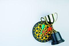 Golden trophy, Darts with crotch  on white background wi Royalty Free Stock Photography