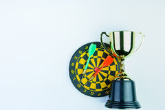 Golden trophy, Darts with crotch  on white background wi Stock Images