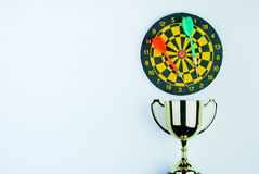 Golden trophy, Darts with crotch  on white background wi Stock Photography
