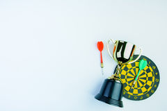 Golden trophy, Darts with crotch  on white background wi Royalty Free Stock Image