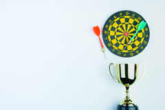 Golden trophy, Darts with crotch  on white background wi Stock Photo