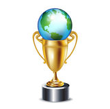Golden trophy with earth globe Royalty Free Stock Photo