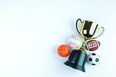 Golden trophy, Football toy, Baseball toy, Basketball toy and Ru Royalty Free Stock Photos