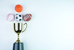 Golden trophy, Football toy, Baseball toy, Basketball toy and Ru Stock Photography