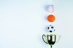 Golden trophy, Football toy, Baseball toy and Basketball toy and. On white background with copy space.Concept winner of the sport royalty free stock image