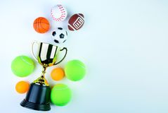 Golden trophy, Football toy, Baseball toy, Ping pong ball, Tennis ball, Basketball toy and Rugby toy isolated on white background. Golden trophy, Football toy royalty free stock images