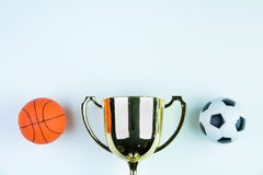 Golden trophy, Football toy and Basketball toy on white. Background with copy space.Concept winner of the sport stock photo