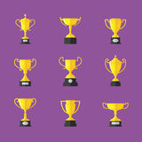 Golden trophy icons set,  on purple background Royalty Free Stock Images