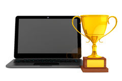 Golden Trophy and Modern Laptop Stock Image
