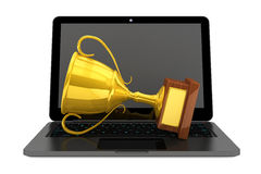 Golden Trophy and Modern Laptop Stock Photos