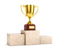 Golden trophy on pedestal Stock Images