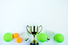 Golden trophy, Ping pong ball, Tennis ball and Shuttlecock isolated on white background with copy space.Concept winner. Golden trophy, Ping pong ball, Tennis stock photos
