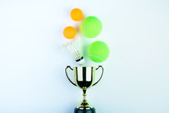 Golden trophy, Shuttlecock, Ping pong ball and Tennis ball isola Stock Photo
