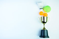 Golden trophy, Shuttlecock, Ping pong ball and Tennis ball isola Royalty Free Stock Images