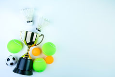 Golden trophy, Shuttlecock, Ping pong ball and Tennis ball isolated on white background with copy space.Concept winner. Golden trophy, Shuttlecock, Ping pong stock image