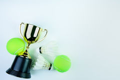 Golden trophy, Shuttlecock and Tennis ball on white bac. Kground with copy space.Concept winner of the sport stock photo