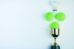 Golden trophy, Shuttlecock and Tennis ball on white bac. Kground with copy space.Concept winner of the sport stock images