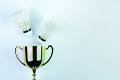 Golden trophy and Shuttlecock  on white background with Stock Photography