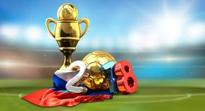Golden trophy soccer football russian colored 2018 3d rendering. Golden trophy soccer football russian colored 2018 front of blurred stadium background 3d Royalty Free Stock Images