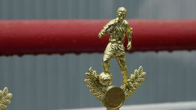 Golden trophy statuette of a football player, the reward for the competition.  stock footage