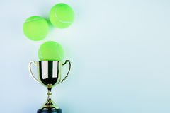 Golden trophy and Tennis ball on white background with. Copy space.Concept winner of the sport royalty free stock photos