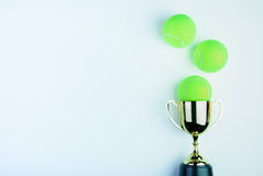Golden trophy and Tennis ball  on white background with Royalty Free Stock Photos