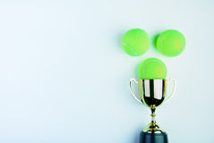 Golden trophy and Tennis ball  on white background with Stock Photos
