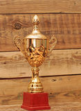 Golden trophy. On wood background stock photography