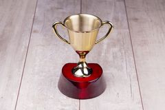 Golden trophy on wood background Stock Photography