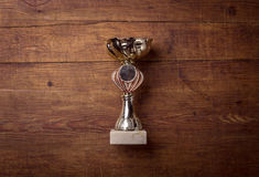 Golden trophy on wood background Stock Photos