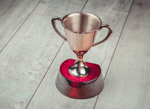 Golden trophy on wood background Royalty Free Stock Photos