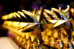 Golden trophys, Awards in the form of stars stock photos