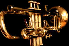 Golden Trumpet on Black Background Royalty Free Stock Photography