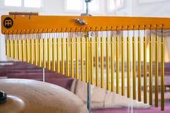Golden tubular bells. Music instrument Royalty Free Stock Photography