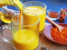 Golden Turmeric Milk or haldi doodh royalty free stock photos